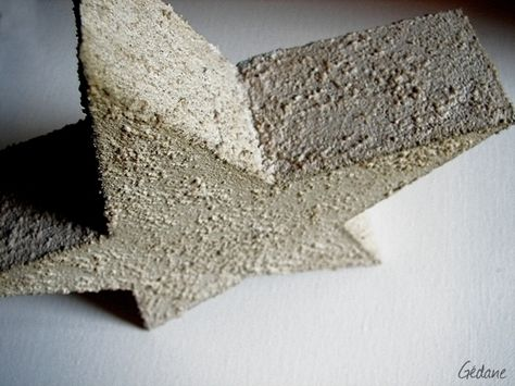Concrete dipped styrofoam...much lighter and easier than casting concrete.