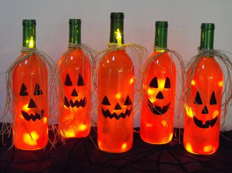 Creative Ways To Use Wine Bottles As Halloween DecorBe creative and decorate your house or porch with some scary decorations made from bottle wines.It's very easy to do and cheap, also. Not to mention they are pretty funny-spooky Halloween accessories. Fall Wine Bottles, Halloween Wine Bottles, Christmas Wine Bottles, Wine Bottle Art, Painted Wine Bottles, Lighted Wine Bottles, Diy Bottle, Bottle Lights, Wine Bottle Lighting