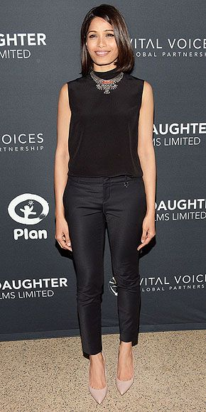 Last Night's Look: Love It or Leave It? | FREIDA PINTO | accenting her black cropped trousers and sleeveless turtleneck with a statement collar necklace and nude pumps at the India's Daughter screening in N.Y.C.