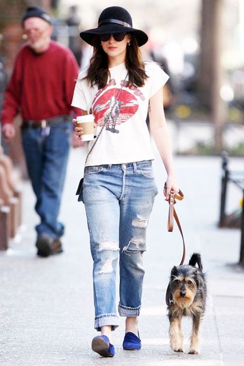 Dakota Johnson Proves It's Time To Ditch Your Skinny Jeans  #refinery29  http://www.refinery29.com/2015/04/85567/dakota-johnson-boyfriend-jeans-outfit#slide-1  Dakota Johnson was photographed walking her dog, Zeppelin, in a Beach Boys band tee, distressed boyfriend jeans, and royal blue loafers.