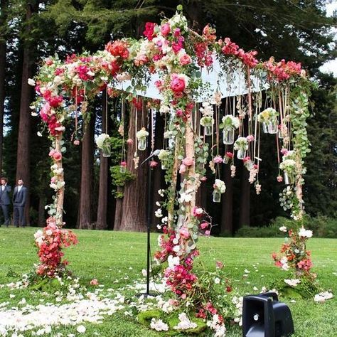 Romantic outdoor pink and red flower wedding ceremony decor Via Amy Burke Designs