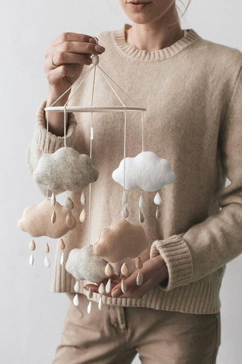 This hand-stitched cloud baby mobile for crib will be perfect crib decoration for your gender neutral nursery. It's also a unique baby gift for a newborn and great baby shower gift too! This cloud mobile will be perfect nursery decoration for Natural, White, Scandinavian or even Boho baby room interiors. It is the element that ties the room together, gives a pop of color, a touch of sweetness or just plain fun for you and baby to enjoy!For each cot mobile I create and draw its own pattern and th