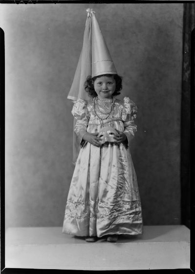 C. Bennette Moore, Untitled (Eugenie Stoll in princess costume holding mask), c. 1935, Harvard Art Museums/Fogg Museum.