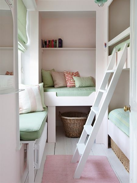 Hard to believe that this small room offers sleeping accommodation for  three small children. A cushioned window seat provides a sunny spot for the