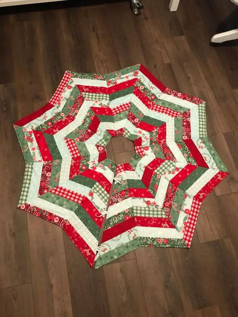 Embellish your Christmas tree with a handmade piece of classic holiday decor. Diy Christmas Tree Skirt, Xmas Tree Skirts, Christmas Tree Skirts Patterns, Christmas Patchwork, Handmade Christmas, Christmas Crafts, Christmas Decorations, Christmas Ornaments, Christmas Projects