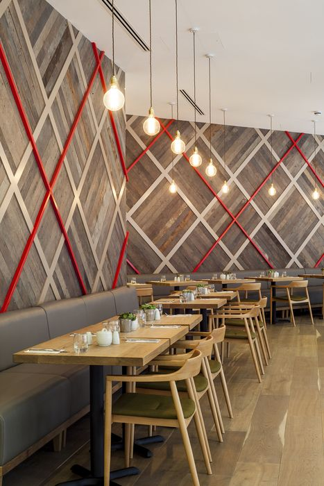 Geometry inspires wood panel wall the royal quarter cafe london designed geometry design restaurant design restaurant furniture restaurant trends