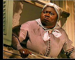 Yelling at Scarlett to come back inside like a respectable young lady.  Mammy - Hattie McDaniel - in Gone With The Wind