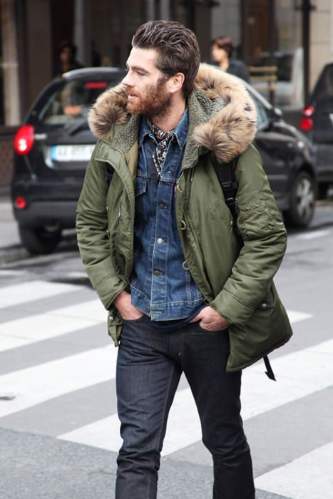 Chris Pine wearing Charcoal Jeans, Navy Crew-neck T-shirt, Blue Denim Jacket, Navy Print Silk Scarf, and Olive Parka