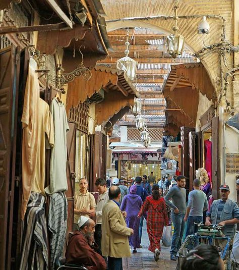 Rue Talaa Kebira, Fes, Morocco this thoroughfare, whose name means 'Great Climb' and which is partly covered by a cane canopy, is lined with small shops along almost it's entire length.