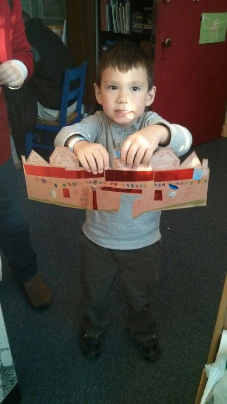 Showing off his Gingerbread Cityscape!