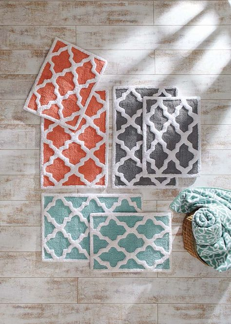 Treat your feet with kindness! Trellis bath mats in blue, coral and gray.