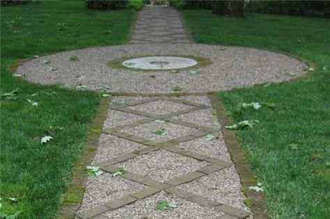 This pea-gravel path gets added interest from recycled brick and a repurposed millstone. Setting other paving materials into a gravel walkway provides additional visual interest as well as stability. Gravel will be less likely to escape from this path because the bricks hold it in place.