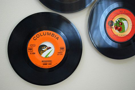 45 vinyl records used as frames for wall art
