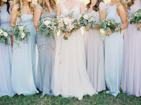 Bridesmaids in pretty shades of pale blue + purple
