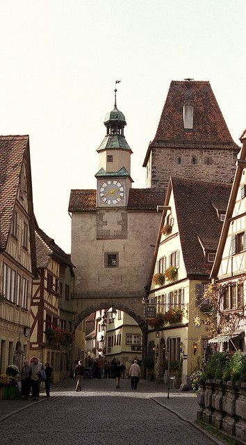 A city gate in Rothenburg, Germany. Rothenburg ob der Tauber is in the Franconia region of Bavaria, Germany. It is well known for its well-preserved medieval old town, a destination for tourists from around the world.