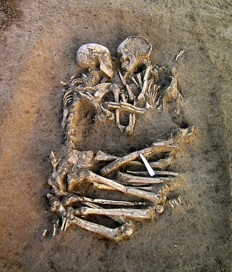 Skeletons locked in embrace. It could be humanity's oldest story. Archaeologists have unearthed two skeletons from the Neolithic period buried outside Mantua, Italy, just 25 miles south of Verona.  After being found at the site where a factory is planned, people worldwide have speculated on the circumstances surrounding the couple's deaths. They are thought to have died young because they both had all their teeth intact. But beyond that? It's a mystery.