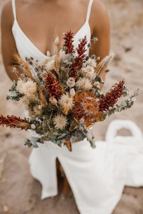 Autumn tones and lots of texture for this beautiful dried wedding bouquet. Photo by Dried Flower Bouquet, Flower Bouquet Wedding, Floral Wedding, Wedding Dried Flowers, Wildflower Wedding Bouquets, Autumn Wedding Bouquet, Non Flower Bouquets, Wildflowers Wedding, Orange Wedding Flowers