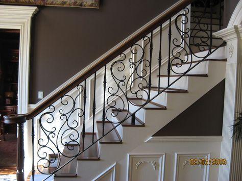Wood flooring, white trim, iron railing