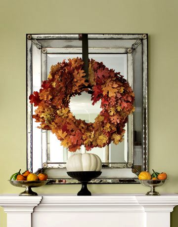 Holiday wreaths are not just for the front door, they look fabulous over the fireplace mantel.