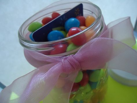 A new way to give a gift certificate as a present...hide it in a jar of yummy and brightly colored candy!