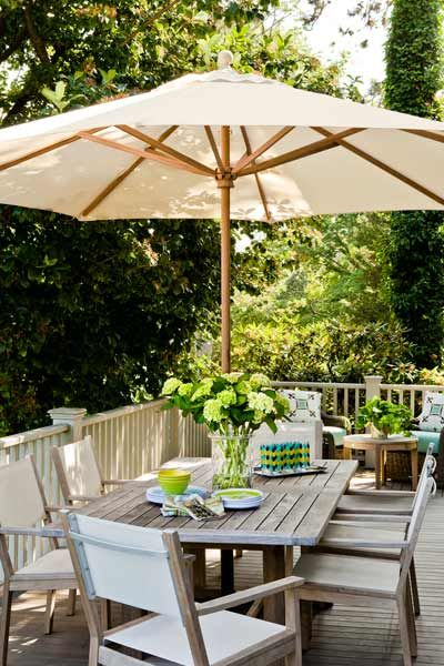 An outdoor umbrella is a time-tested deck and patio go-to that helps keeps diners cooler for longer spurts of entertaining. Click here for some of favorite patio umbrella picks.