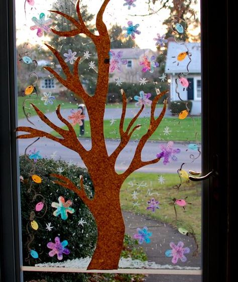 A fun way to decorate glass door or window with your kids.  Use painted coffee filters and acrylic paint or window crayons.  Younger kids can help paint the filters.