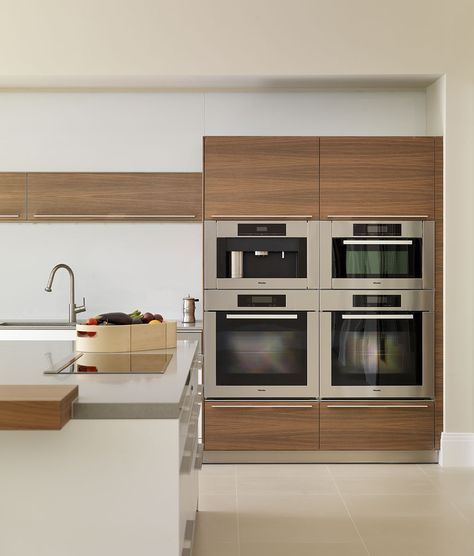 contemporary white and wood kitchen | block of Miele appliances #miele #kitchens