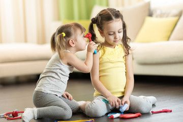 Funny Kids Playing Doctor With Toy Tools Children Sitting On Floor In Living Room Spon Doctor Toy Playi In 2020 Kids Playing Doctor Playing Doctor Funny Kids
