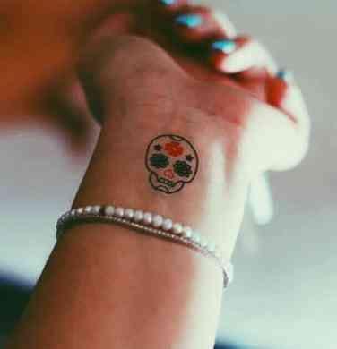 50 Stunning Sugar Skull Tattoo Design Ideas Their Meanings Small Skull Tattoo Candy Skull Tattoo Mexican Skull Tattoos