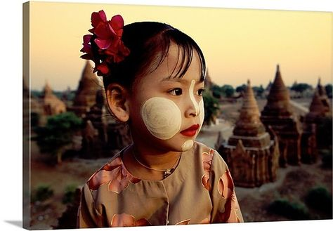 Young Burmese Girl with tanaka facepaint above the temples of Bagan, Burma, by Scott Stulberg | via @greatbigcanvas