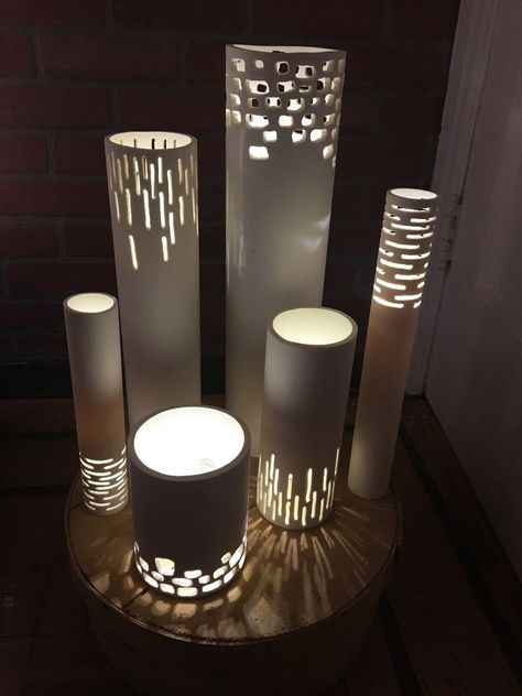 Who doesn't love a good lamp to add some soft light to a room? These PVC pipe lights not only add a nice glow but cast beautiful shapes around them and add a nice touch of character too!- She draws a small box on PVC pipe, cuts it out & gets GORGEOUS deco Diy Luminaire, Diy Lampe, Pvc Pipe Crafts, Pvc Pipe Projects, Dremel Projects, Upcycling Projects, Backyard Projects, Outdoor Projects, Pipe Lighting