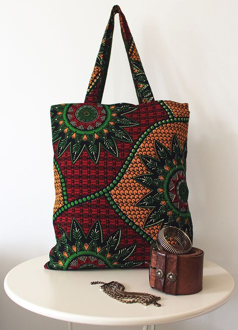Handmade in Italy bag with a fabric from Tanzania. Fully lined with a striped fabric from Italy. Tote bag, Summer bag, big bag.  Sold.