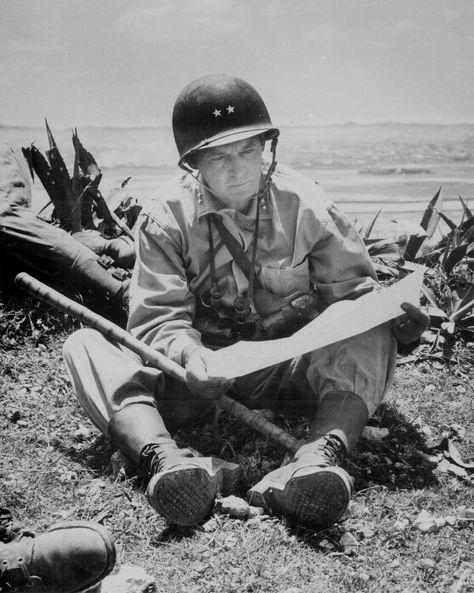 Marine Major General Lemuel Shepherd of the 6th Marine Division studied a map on Okinawa, Jun 1945.