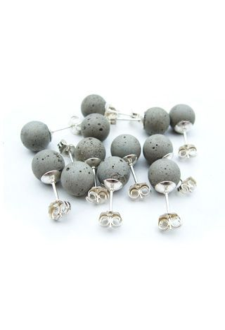Cement earrings modeled on classic pearl studs. Each concrete sphere is cast by hand and set onto a sterling silver post. With wear, the color of earrings will deepen as the concrete is exposed to the air and the oils from your skin.