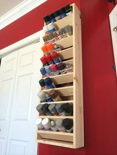 Spray can holder hung with french cleats. Would a miniature version work for our large collection of acrylic paint?