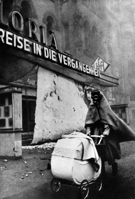 Wolf Strache, Woman with Gasmask, 1943...     The signs in the background (movie theater) saying: JOURNEY TO THE PAST.. That's a phantastic photo, a message, done 1943!! ..