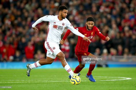 Lys Mousset of Sheffield United takes the ball past Joe Gomez of...