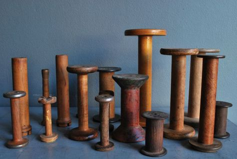 I have some of these and I love them! Old industrial thread spools. They make great candle sticks.