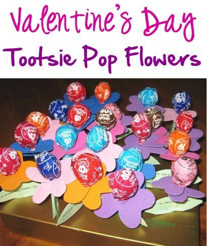 Valentine's Day Tootsie Pop Flowers! ~ at TheFrugalGirls.com ~ such a fun twist on classroom candy to pass out!  #valentinesday #crafts #thefrugalgirls