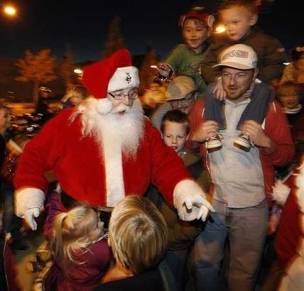 Kids run out to hug Santa as he arrives to recieve his Christmas ...