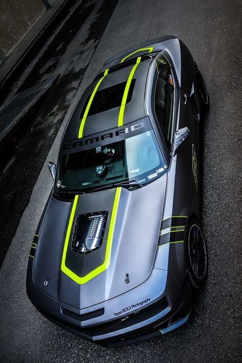 black and fluorescent yellow/green...I actually kinda like it even though not a big fan of camaros