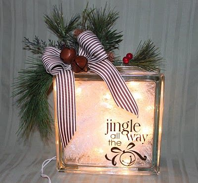 """We had a gift exchange at our weSTAMP Christmas party. This is the gift I made for the exchange. I added the """"Jingle All the Way"""" Decor Elements to the glass block. On the inside, I put a small strand of white lights and some inexpensive white tinsel that I found at Target."""
