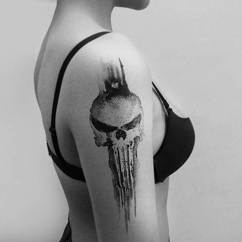 The Punisher inspired tattoo on the right upper arm. Tattoo Artist: Hongdam