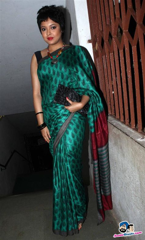 Tanushree: funky haired, but still nice and curvy.