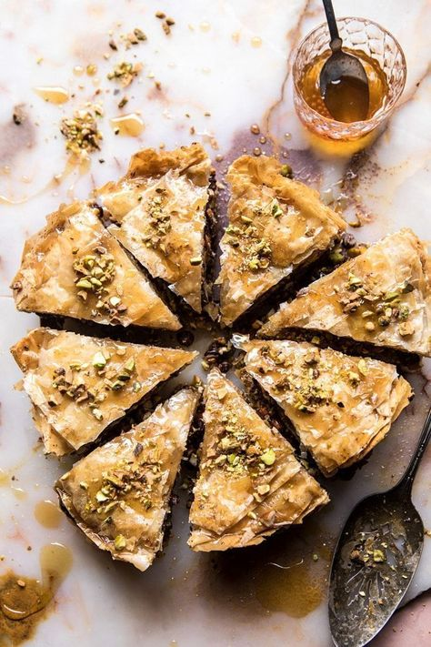 A lightened up and easier-to-make version of the traditional Baklava. Get the recipe: Easy Pistachio Chocolate Baklava Greek Desserts, Köstliche Desserts, Greek Recipes, Dessert Recipes, Plated Desserts, Health Desserts, Cake Recipes, Chocolate Baklava, Almond Chocolate