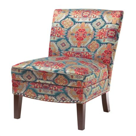 The perfect marriage of convenience and comfort, this chairs graceful shaped back and armless styling combined with its colorful Navajo tribal pattern will make for a great accent to any rooms décor.
