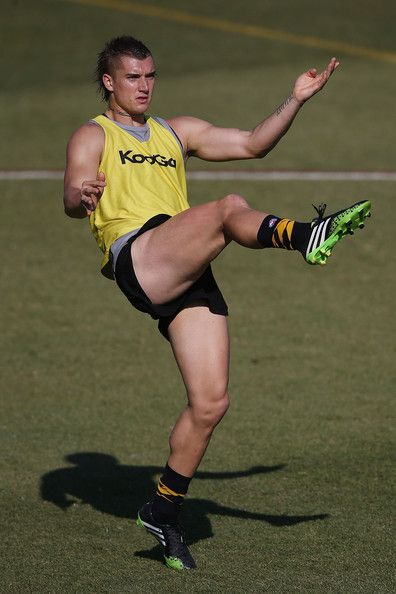Dustin Martin Photos - Dustin Martin kicks the ball during a Richmond Tigers AFL training session at ME Bank Centre on December 2013 in Melbourne, Australia.