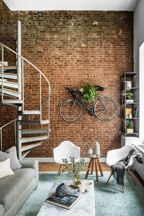 This home looks a bit usual but the uniqueness and originality gives it a bike on the wall as the base for the plant. Very interesting detail.