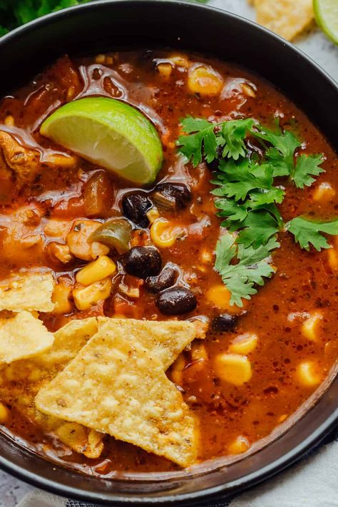 Chicken Tortilla Soup is a hearty Mexican soup that really warms the soul. Topped with fried tortilla chips, its packed with flavour and will be a great addition to your dinner rotation! Authentic Chicken Tortilla Soup, Mexican Tortilla Soup, Creamy Chicken Tortilla Soup, Mexican Soup Recipes, Chicken Enchilada Soup, Tortilla Chips, Best Tortilla Soup Recipe, Slow Cooker Tortilla Soup, Hearty Chicken Soup