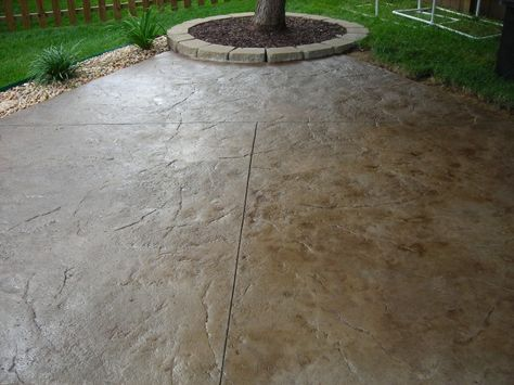 stamped concrete patio fire pit sitting wall for lower area by